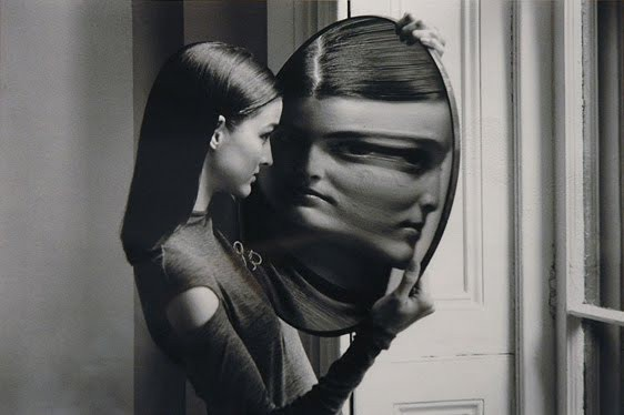 teen looking at the mirror